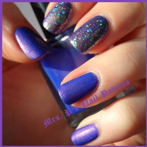 This is 3 coats of Blue/Purple Shifty with one coat of Pretty As A Peacock over top on accent nails. All topped off with a coat of Seche Vite dry fast top coat. Mrs. P's Nail Potions are available at www.etsy.com/shop/MrsPsNailPotions