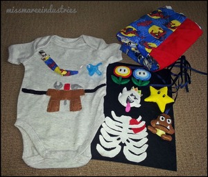 I made the following: - tool belt and sewed it onto the onesie. - pacifier clip - baby quilt - ribcage with love heart (to be sewn onto a black onesie) - mario characters for a hanging decoration.  These were all really easy to make items and I did so without any tutorial or patterns. :)
