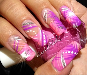 The colors I used to achieve this look are Essie grow stronger as my base, Essie Cascade Cool and pink light purple and white acrylic paints with some silver glitter accents I sealed in my design with Seche Vite