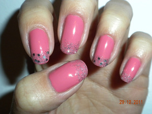 New year nails: Medium pink base with silver glitter and accent nails with small silver holograms