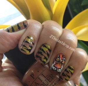 Eye of the tiger manicure http://2thelastdrop.com/2012/01/13/31-day-nail-challenge-day-13-animal-nails/