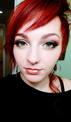 Green and red are what I think of when Christmas comes around. such fun dramatic colors. So I have created this very classy yet fun look for you. a fade from light green to dark into black in the crease, red faded over top with a touch of pink to blend into the highlight. Gold underneath meeting a dark green glitter. False lashes followed with Kat von d's forever never lipstick and a sugar gloss.