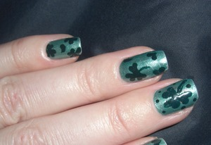 I didn't have the color green I wanted so I mixed silver (Broadway Nails-Queen of Evening) and a teal green (Maybelline-Shocking Seas). I topped off my new metallic green with some clovers in CQ-Slate