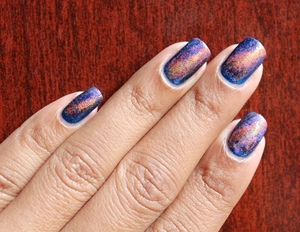 Use the sponging technique to get these gorgeous galaxy nail! For more information see my blog:  http://chinadolltt.blogspot.com/2012/07/galaxy-nails-with-tutorial.html