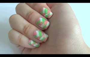 Hi! These is my fishtail braided nails (: I really like the design. I felt that it was a little messy though. I chose these colors because they seem so spring-like! I have a video on this (: