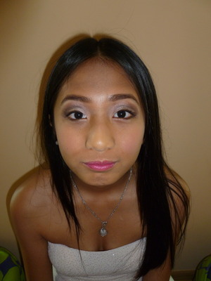 Brown eye with shimmer and pink undertones paired with a pink lip