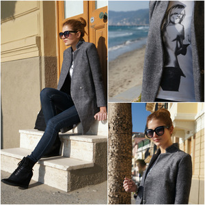 Grey coat,featuring a small stand collar with V-shape front,long sleeve style,an invisble magic button front,two pockets lower front,a nice stitching and rhombus stitching inside,cut in a regular fit.