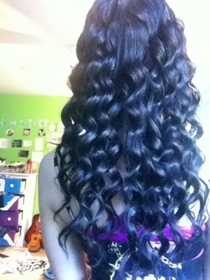 Curled my hair for no reason and decided to post a picture of it:) who likes and who doesn't? I just wrapped my hair around only one of the barrels, and it curled nicely(: