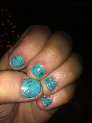Pinks new sea foam green color with a glitter on top