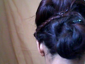 I found this great hair tutorial on Youtube. You will need about 10 black bobby pins and 3 embellished pins as well.