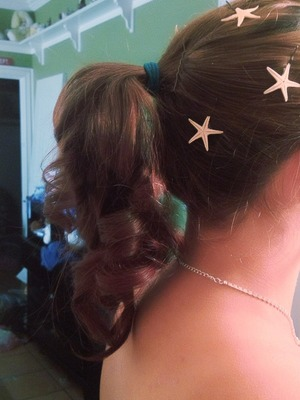 The starfish are real, glued to hair pins.