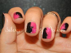 Nail art created by swirling wet polishes with a needle.