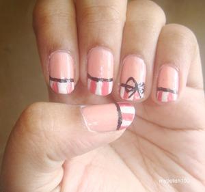 http://mypolish100.blogspot.in/2013/04/pinstripe-bow-nails-tutorial.html