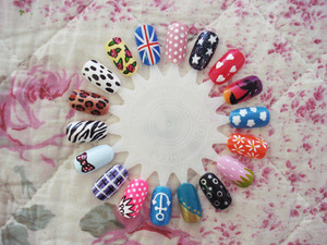 My first nail art wheel! I was asked in my manicure class to make 50 designs and these were the first ones that came out of the oven ;). You can see close ups at my blog: http://elburnbook.blogspot.com/2011/11/my-first-nail-wheel.html