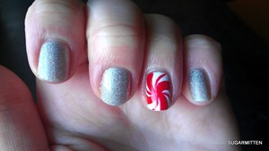 http://sugarmitten.wordpress.com/2011/12/25/christmas-nails-part-two/