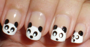 Panda Nails, using white and black polish with a sheer nude color underneath.