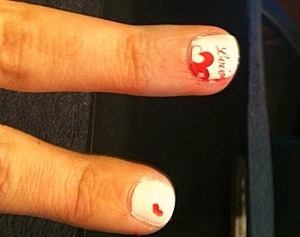 I dont know why the pics are sideways i uploaded them the right way, anyway valentines day nail art its says lovely with a heart