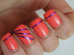 Purple metallic striping tape used over China Glaze Surreal Appeal. Full details can be found on my blog http://www.lacquermesilly.com/2013/01/19/china-glaze-surreal-appeal-and-some-striping/