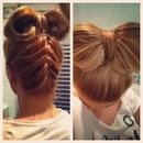 Upside down French plait/braid with a bow bun