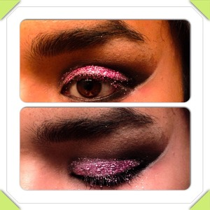 A dramatic dark smokey eye with foiled pink and purple lid color. Stripe of white along outer edge