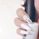 Off white nails with Swarovski cross nails