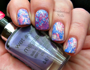 Please visit my blog for more info http://wonderland-nails.blogspot.com/2013/07/tutorial-multi-colored-water-spotted.html