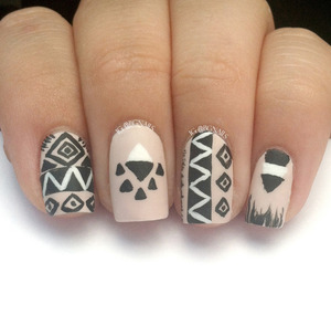 A manicure with zig zags, lines, triangles, etc to make a gorgeous design!