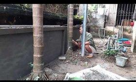 Làm bờ tường sau cây cột điện