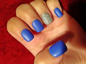 Blue nails with glitter.