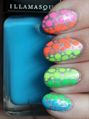 See more swatches of my manicure here and to learn the names of all the nail-polish colours I used: http://www.swatchandlearn.com/nail-art-neon-rainbow-dotticure/