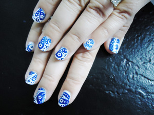 i gave my mom a decorated mani ^^ again- i got this look from IndigoNova1- she's so talented. here's the link: http://www.youtube.com/watch?v=F0rFm787nY8&feature=channel_video_title