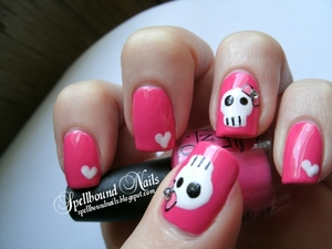 http://spellboundnails.blogspot.com/2012/05/bowed-skulls-and-hearts.html