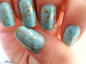 I did this by painting gold onto scrunched up glad wrap and dabbing it my nail. EASIEST THING EVER. I have a video tutorial for this somewhere too, 'case you cared ;) the colours I used were essie- mnit candy apple and Orly-luxe