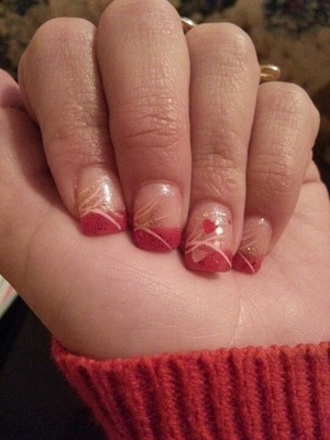 My Valentine's Day inspired nail design this year.  Sparkly red gel polish with gel glitter hearts in a sparkly polish also, topped off with pink and gold lines.  =)