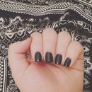 Leather matte black french manicure.