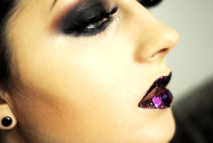 Decided to move away from the classic 'red lips on Valentine's day' look and focus on creating a darker, sexier (I hope) look. Also added purple hearts and glitter to my lips, which isn't the most kissable makeup going but sure, gwan. xo