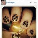 gold leopard nails.