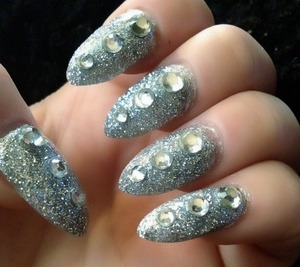 Made by me I used silver glitter nail polish a different sizes of clear rhinestones ;)