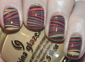 A striped fall water marble using polishes from the China Glaze On Safari Collection!  Polishes Used: China Glaze: Kalahari Kiss Exotic Encounters Purr-fect Plum Top Coat: Butter London Hardwear  Full Blog Post: http://packapunchpolish.blogspot.com/2012/11/fall-water-marble-nails.html