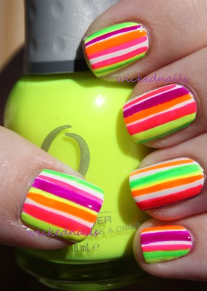 I painted my nails white and then, using an Orly Striping Brush, painted on thinner and thicker stripes in various neon colors. I'm holding Orly Glowstick.