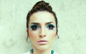http://www.theglamcrush.com/2012/01/blue-feather-lashes-and-rhinestones.html