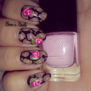 Redid an old mani inspired by one of Betsy Johnson designs. Black base with neutral leopard print; accented with two-toned pink roses.