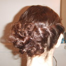 Twisted curly side bun