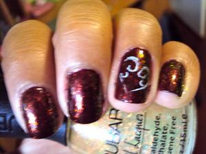 A flakie nail polish spices up a regular color polish.