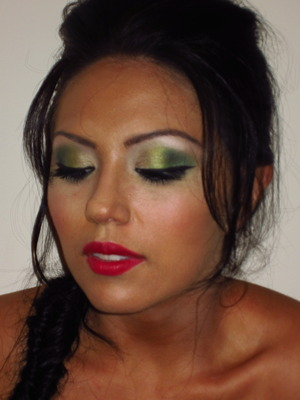 lime green to dark green eyes teamed with a red sexy lip and a brushing of pink blush