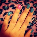 Turquoise nails with hot pink accent nail.