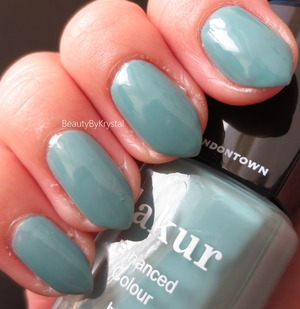 This is a creme formula, opaque in two coats. A cool toned, dusty, pastel teal - it leans more green in daylight and more blue in the shade. http://www.beautybykrystal.com/2013/10/londontown-lakur-enhanced-colour.html