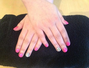 Pink nails with ring finger black and white stripes