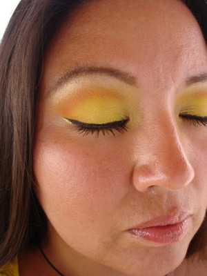 yellow and orange..  black cat eyelinver and a touch of gold.