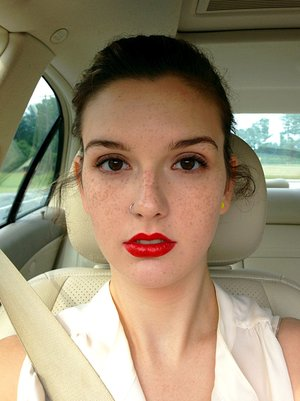 Red lips, natural eyes, barely-there skin correction.